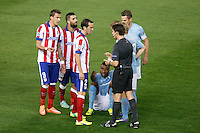 Atletico de Madrid´s Mandzukic, Arda Turan and Diego Godin and Malmo´s Adu during Champions League soccer match between Atletico de Madrid and Malmo at Vicente Calderon stadium in Madrid, Spain. October 22, 2014. (ALTERPHOTOS/Victor Blanco)