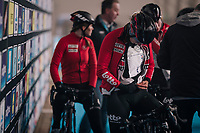 1 of the Lotto-Soudal ladies getting an old-school wind layer stuffed in (against the freezing temperatures outside) at the pre-race team presentation<br /> <br /> Omloop Het Nieuwsblad 2018<br /> Gent &rsaquo; Meerbeke: 122km (BELGIUM)