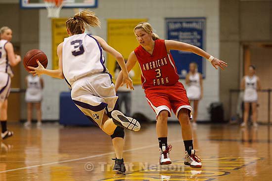 Taylorsville - Riverton vs. American Fork High School girls basketball, 5A State Championship game Saturday February 28, 2009 at Salt Lake Community College..American Fork's Cydne Mason (3) Riverton's Bri Campbell (3)