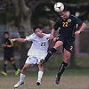 Oliver Escobar #22 of Uniondale, right, heads a ball away from Shunta Iio #23 of Syosset during a Nassau County Conference AA-1 varsity boys soccer game at Uniondale High School on Tuesday, Oct. 2, 2018.