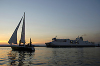 Sailboat and a ferry in the harbor, Marseille, France.