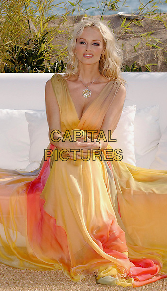 ADRIANA KAREMBEU - ADRIANA KAREMBU.Adriana Sklenarikova wonderbra model.Cannes Film Festival 2003.www.capitalpictures.com.sales@capitalpictures.com.©Capital Pictures.multi coloured, rainbow, toga dress, chiffon, baby doll, roman, cleavage