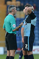 Wycombe Wanderers Garry Thompson about to be booked by referee Seb Stockbridge during the Sky Bet League 2 match between Mansfield Town and Wycombe Wanderers at the One Call Stadium, Mansfield, England on 31 October 2015. Photo by Garry Griffiths.