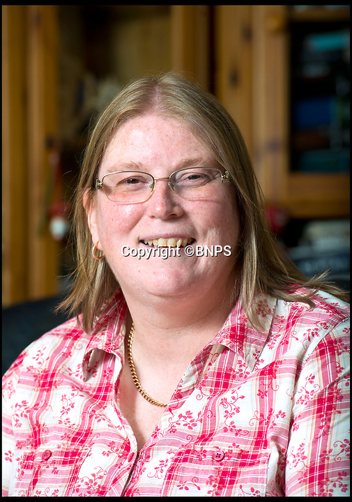 BNPS.co.uk (01202 558833)<br /> Pic: RachelAdams/BNPS<br /> <br /> ***Please use full byline***<br /> <br /> Wendy Morrell at home in Bournemouth . <br /> <br /> A woman was startled when a huge eagle swooped into her front room and landed on a cabinet while she was watching TV.<br /> <br /> Wendy Morrell couldn't believe her eyes when the 18ins tall bird of prey flew through open patio doors and into her lounge in Poole, Dorset, yesterday.<br /> <br /> The bird, a Russian Steppe eagle, knocked over ornaments with its 4ft wings as it landed on a wooden glass cabinet before pecking at a bowl of pot pourri.<br /> <br /> Wendy and friend Karen Ruddlesden tried to tempt the eagle outside using pieces of ham but when their attempts failed they phoned a local bird of prey rescue centre.<br /> <br /> After 30 minutes of trying the eagle was eventually lured down off its makeshift perch using a dead chick.<br /> <br /> It was revealed later that the young bird was called Storm and was being trained up to ward off seagulls at a nearby landfill site.<br /> <br /> It had been reported missing by owner James Moore three days prior to turning up at Wendy's house after it broke its tethers.