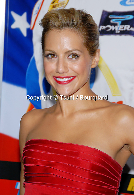 Brittany Murphy arriving at the Talladega Nights Premiere at the Chinese Theatre In Los Angeles. July 26, 2006.<br /> <br /> eye contact<br /> headshot<br /> smile