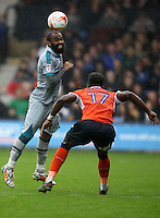 Dominic Vose of Grimsby Town and Pelly-Ruddock Mpanzu of Luton Town during the Sky Bet League 2 match between Luton Town and Grimsby Town at Kenilworth Road, Luton, England on 10 September 2016. Photo by Harry Hubbard / PRiME Media Images.