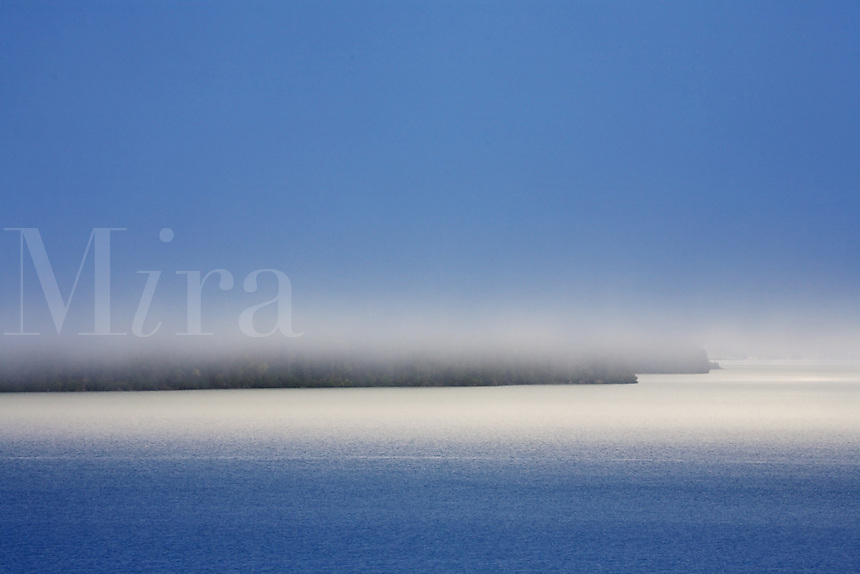 Morning fog on Kenai Lake, Kenai Peninsula, Chugach National Forest, Alaska.