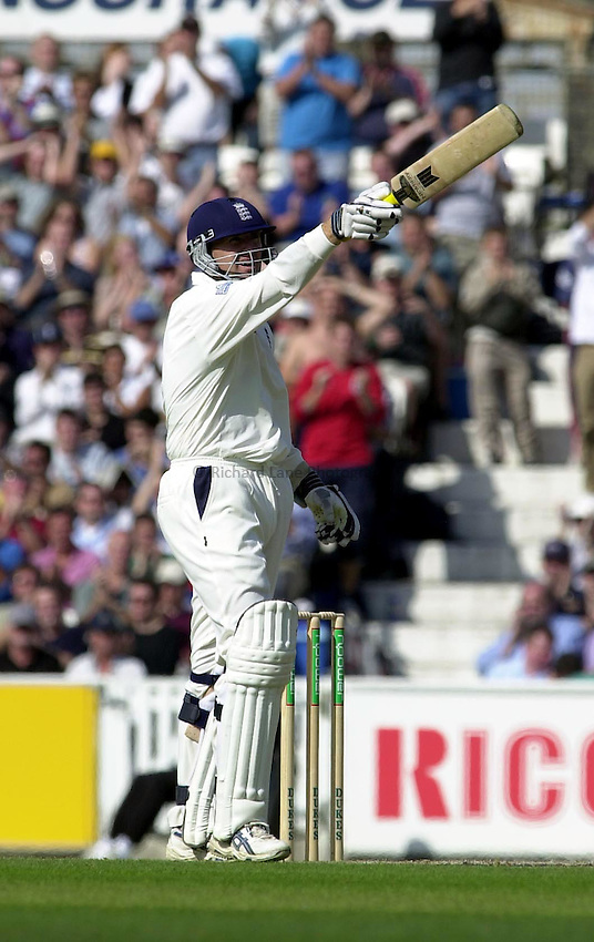 Photo Peter Spurrier.31/08/2002.05/09/02.4th NPower Test. The Oval..England vs India..Dominic Cork points high into the pavilion with his bat making a gesture as he is selected for the ICC squad.