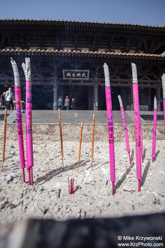 Incense sticks burning in front of a Buddhist temple at the Yungang Grottoes in Datong, China