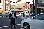 March 17th, 2011. A policeman stops traffic as traffic lights in Chiba are switched off as part of a rotating power blackout in the greater Tokyo area. People's lives have been disrupted in the greater Tokyo area as Tokyo Electric Power Co. began its first-ever rolling blackout to help prevent an unexpected large-scale power outage after a powerful earthquake shut two nuclear plants indefinitely on Friday 11th March.