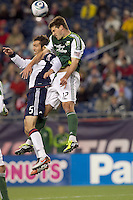 New England Revolution defender A.J. Soares (5) and Portland Timbers defender David Horst (12) battle for head ball. In a Major League Soccer (MLS) match, the New England Revolution tied the Portland Timbers, 1-1, at Gillette Stadium on April 2, 2011.