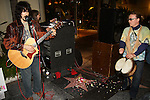 "ZANE SUAREZ & QUASI MOJO. The guitarist and drummer lead George Harrison songs at the George Harrison Public Birthday Celebration by the Alliance for Survival, hosted by Jerry Rubin and ""Breakfast with the Beatles"" radio host Chris Carter at George Harrison's star on the Walk of Fame. Hollywood, CA, USA. February 25, 2010."