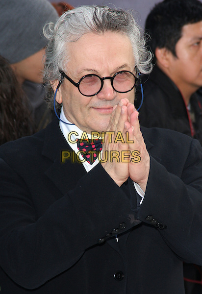 George Miller.European Premiere of 'Happy Feet Two' at the Empire Leicester Square, London, England..November 20th 2011.half length black coat jacket glasses hands together praying .CAP/ROS.©Steve Ross/Capital Pictures