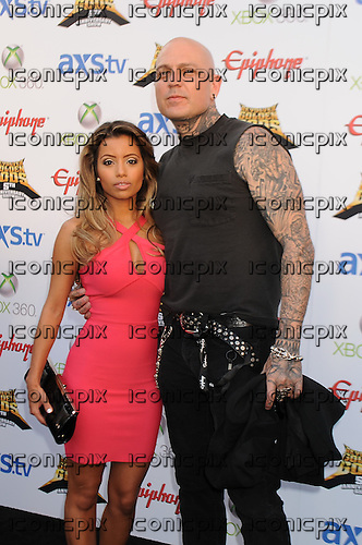 Adult film star Lupe Fuentes and musician Evan Seinfeld walk the Black Carpet at the Revolver Golden Gods Awards presented by Epiphone held at Club Nokia in Los Angeles, CA USA on May 2, 2013. Photo © Kevin Estrada / IconicPix