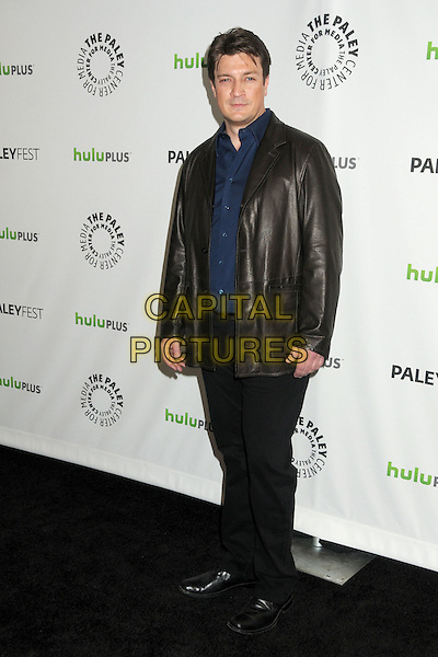 "Nathan Fillion.PaleyFest 2012 Presents ""Castle"" held at The Saban Theatre, Beverly Hills, California, USA, 9th March 2012..full length jacket blue shirt black leather trousers .CAP/ADM/BP.©Byron Purvis/AdMedia/Capital Pictures."