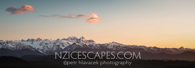 Sunset over Southern Alps with Aoraki, Mount Cook and Mount Tasman. Franz Josef Glacier visible on left, Westland Tai Poutini National Park, West Coast, UNESCO World Heritage Area, South Westland, New Zealand, NZ