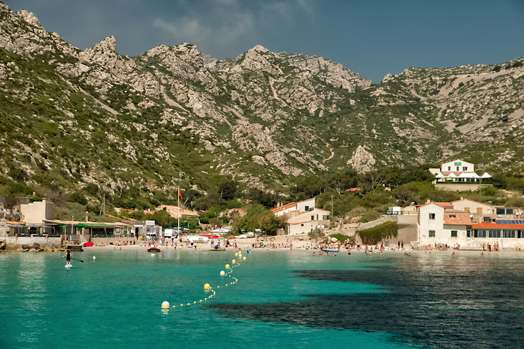 Emerald green waters of isolated coves and small hamlets are scattered along the Les Calanques coastline.