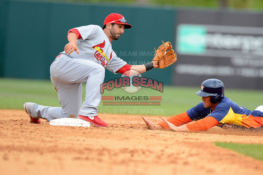 Houston Astros outfielder George Springer #75 slides into second as Daniel Descalso #33 takes the throw during a Spring Training game against the St. Louis Cardinals at Osceola County Stadium on March 1, 2013 in Kissimmee, Florida.  The game ended in a tie at 8-8.  (Mike Janes/Four Seam Images)