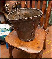 BNPS.co.uk (01202 558833)<br /> Pic: PhilYeomans/BNPS<br /> <br /> Ray Ives Locker<br /> <br /> 19th century leather fire bucket.<br /> <br /> Old man of the sea Ray Ives has opened his very own Davy Jones' locker of hundreds of nautical treasures he has salvaged from the seabed.<br /> <br /> Ray(77) has spent 40 years amassing a huge trove of historical artefacts that he has found during thousands of deep sea dives off the British coast.<br /> <br /> Ray's watery Aladdins cave includes canon balls, muskets, swords and even the bell from an ocean liner sunk by a German U-boat in the First World War.<br /> <br /> For years Ray had stuffed his collection into a tiny shed in the back garden of his home in Plymouth, Devon.<br /> <br /> But now the fascinating archive has now gone on display to the public in a ramshackle museum made from shipping containers.