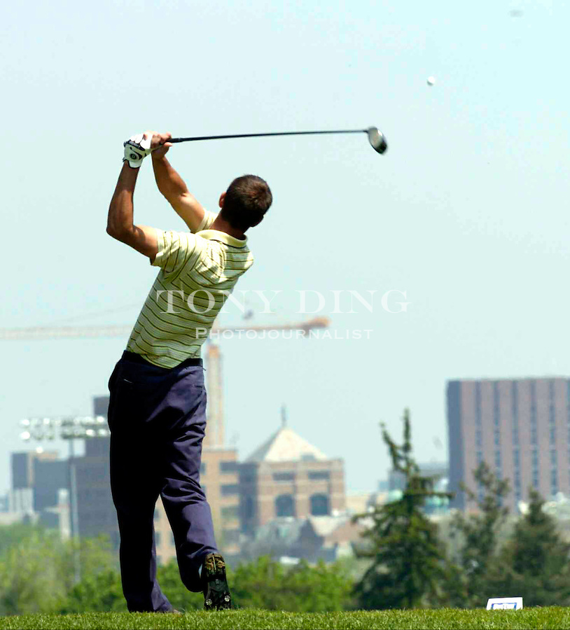 Michigan senior Rob Tighe tees off on the ninth hole during the Big Ten Men's Golf Championship at the U of M Golf Course on Sunday, May 9, 2004 in Ann Arbor, Mich. (Photo by TONY DING/The Michigan Daily)