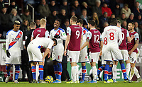 Burnley's Ben Mee and Crystal Palace's Wilfried Zaha exchange words following a second half altercation <br /> <br /> Photographer Rich Linley/CameraSport<br /> <br /> The Premier League - Burnley v Crystal Palace - Saturday 30th November 2019 - Turf Moor - Burnley<br /> <br /> World Copyright © 2019 CameraSport. All rights reserved. 43 Linden Ave. Countesthorpe. Leicester. England. LE8 5PG - Tel: +44 (0) 116 277 4147 - admin@camerasport.com - www.camerasport.com