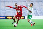 Stockholm 2014-05-04 Fotboll Superettan Hammarby IF - IFK V&auml;rnamo :  <br /> V&auml;rnamos Sebastian G&ouml;ransson i kamp om bollen med Hammarbys Michael Timisela <br /> (Foto: Kenta J&ouml;nsson) Nyckelord:  Superettan Tele2 Arena Hammarby HIF Bajen V&auml;rnamo