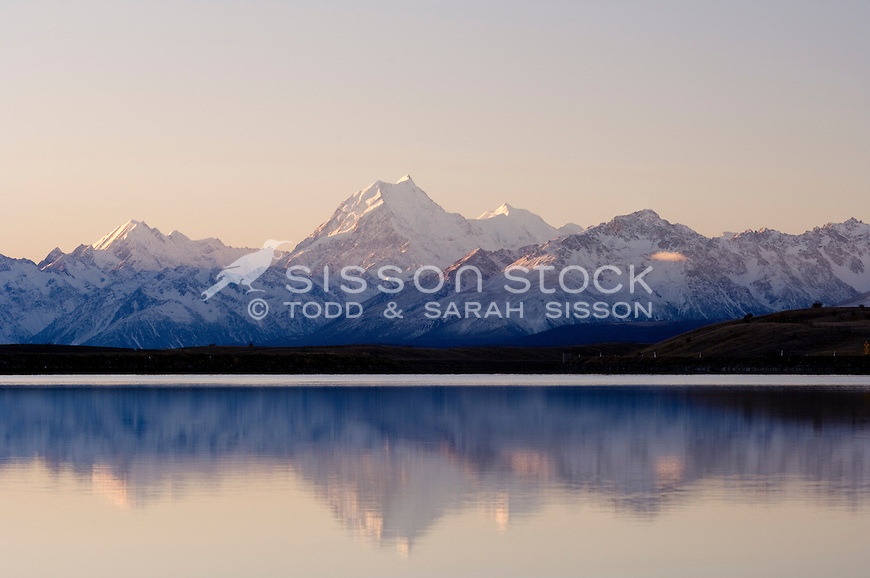 Mount Cook / Aoraki is reflected in the Tekapo canal at sunset