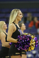 SEATTLE, WA - DECEMBER 18: Washington cheerleader Annie Millspaugh entertained fans during a timeout against Savannah State.  Washington won 87-36 over Savannah State at Alaska Airlines Arena in Seattle, WA.