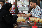 A Palestinian goldsmith displays Chinese jewellery at a jewellery shop in the southern Gaza Strip town of Rafah on September 12, 2011. The price of the Chinese gold is 15 dollars instead of 50 dollars for the other original kind. Photo by Hatem Omar