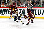ST PAUL, MN - APRIL 7: Blake Young #17 of the Minnesota-Duluth Bulldogs races Jack Jenkins #28 of the Notre Dame Fighting Irish for the puck during the Division I Men's Ice Hockey Semifinals held at the Xcel Energy Center on April 7, 2018 in St Paul, Minnesota. (Photo by Carlos Gonzalez/NCAA Photos via Getty Images)