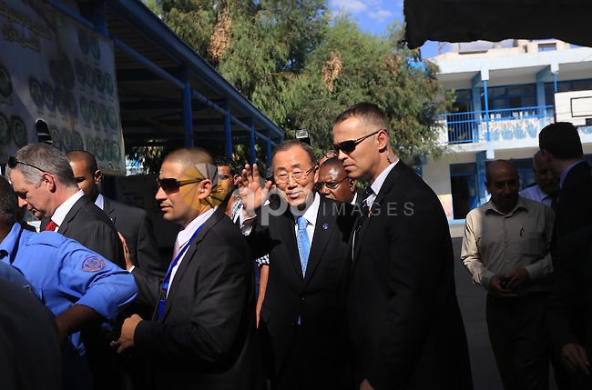 United Nations (UN) Secretary General Ban Ki-moon arrives at Abu Hussein United Nations school at the Jabalia refugee camp in the northern Gaza Strip on October 14, 2014.  The UN chief's visit to the Gaza Strip came a day after a Cairo conference at which international donors pledged USD 5.4 billion (4.3 billion euros) to rebuild the war-ravaged Gaza Strip. Photo by Mohammed Asad