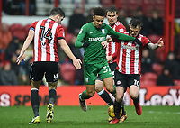 Preston's Callum Robinsonbattles with Brentford's John Egan and Josh McEachran<br /> <br /> Photographer Jonathan Hobley/CameraSport<br /> <br /> The EFL Sky Bet Championship - Brentford v Preston North End - Saturday 10th February 2018 - Griffin Park - Brentford<br /> <br /> World Copyright &copy; 2018 CameraSport. All rights reserved. 43 Linden Ave. Countesthorpe. Leicester. England. LE8 5PG - Tel: +44 (0) 116 277 4147 - admin@camerasport.com - www.camerasport.com
