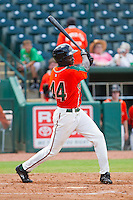 Juancito Martinez (44) of the Greensboro Grasshoppers follows through on his swing against the Augusta GreenJackets at NewBridge Bank Park on August 11, 2013 in Greensboro, North Carolina.  The GreenJackets defeated the Grasshoppers 6-5 in game one of a double-header.  (Brian Westerholt/Four Seam Images)
