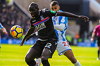 Crystal Palace's defender Mamadou Sakho (12) beats Huddersfield Town's forward Collin Quaner (23) during the EPL - Premier League match between Huddersfield Town and Crystal Palace at the John Smith's Stadium, Huddersfield, England on 17 March 2018. Photo by Stephen Buckley / PRiME Media Images.