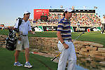 Rory McIlroy awaits a ruling after his 3rd shot ends up in the stream at the 18th green during  Day 3 at the Dubai World Championship Golf in Jumeirah, Earth Course, Golf Estates, Dubai  UAE, 21st November 2009 (Photo by Eoin Clarke/GOLFFILE)