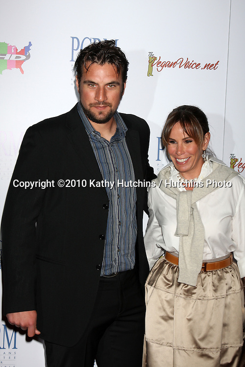 """Melissa Rivers & Date.arrives at """"The Art of Compasion PCRM 25th Anniversary Gala"""".The Lot.Los Angeles, CA.April 10, 2010.©2010 Kathy Hutchins / Hutchins Photo..."""
