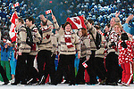 Members of Team Canada walk in and wave to the crowd at BC Place in Vancouver during the opening ceremonies of the 2010 Paralympic Games.