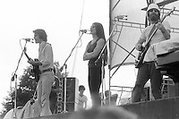 Jerry Garcia, Donna Jean Godchaux and Ned Lagin watching from the wing. Grateful Dead Live at Dillon Stadium, Hartford, CT 31 July 1974 featuring the Wall of Sound.