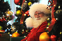 NWA Media/ J.T. Wampler - Santa smiles at children Wednesday Dec. 24, 2014 at Pinnacle Hills Promenade. Santa was on hand until early evening for photographs and gift requests.