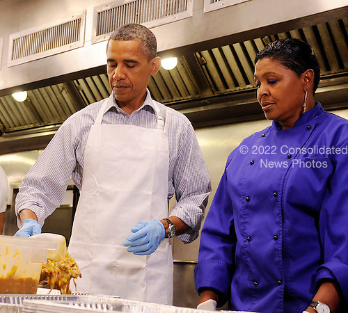 United States President Barack Obama and Marianne Ali participate in a service project at DC Central Kitchen, on Saturday, September 10, 2011, in Washington, DC.  .Credit: Leslie E. Kossoff / Pool via CNP