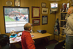 Looking out for Sheffield Wednesdays score in the Sheffield FC boardroom. Sheffield FC 1 Hallam 1, 14/10/2006. Coach and Horses Stadium, The worlds oldest derby. Hallam scored a last minute equaliser. Photo by Paul Thompson.