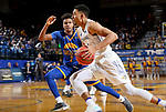 SIOUX FALLS, SD - NOVEMBER 28: Skyler Flatten #1 from South Dakota State University gets a step past Rob Whitfield #2 from UMKC during their game Wednesday night at Frost Arena in Brookings, SD. (Photo by Dave Eggen/Inertia)