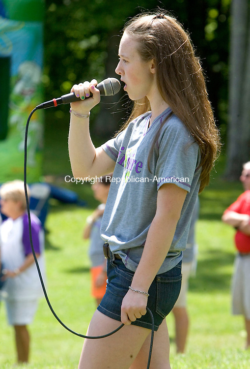 SOUTHBURY CT. 07 June 2014-060714SV18-Sarah Fradkin, 13, sings the National Anthem before hundreds of walkers take off on a 2.74 mile walk during the S4 Epilepsy Walk in Southbury Saturday. The walk, dinner and silent auction was held at Ballantine Park and Organized by the Fradkin family. Sarah Morgan Fradkin, 13, has Epilepsy and the family is fighting the disease with the annual fundraiser. Sarah&rsquo;s quest to lead a seizure-free life is their mission.<br /> Steven Valenti Republican-American