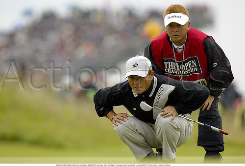 SHIGEKI MARUYAMA (JPN) and his caddie YUKI SAITO line up a putt. The Open Championship, Muirfield, Scotland 020719 Photo:Glyn Kirk/Action Plus...Golf golfer.2002 caddies.