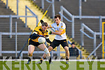 Curros Johnny Buckley is put under pressure from John Payne Dr Crokes during the O'Donoghue Cup semi final clash in Fitzgerald Stadium on Saturday