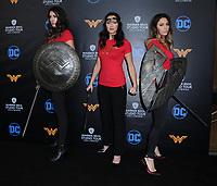 31 July 2017 - Burbank, California - Caitlin Dechelle, Samantha Jo, Mickey Facchinello.  Warner Bros. Studio Tour Hollywood Adds Wonder Woman Exhibit to DC Universe: The Exhibit held at Warner Bros. Studios in Burbank. Photo Credit: Birdie Thompson/AdMedia