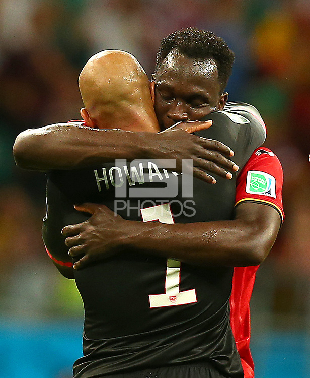 Romelu Lukaku of Belgium hugs former Everton team mate USA goalkeeper Tim Howard at full time