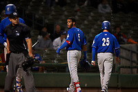Rancho Cucamonga Quakes first baseman Cristian Santana (5) and Stockton Ports catcher Jonah Heim (not pictured) continue to exchange words after Santana's home run during a California League game against the Stockton Ports at Banner Island Ballpark on May 16, 2018 in Stockton, California. Rancho Cucamonga defeated Stockton 6-3. (Zachary Lucy/Four Seam Images)