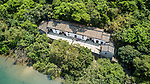 Sheung Yiu Village And Sorrounds Viewed From  A Drone.  This Is A Fortified Hakka Village Built On Raised Ground In Around 1850.  Consists Of A Row Of Eight Houses And Is Entered Via A Watch Tower.  Prospered Briefly Due To Its Lime Kiln.  Since Restoration In 1983, Has Operated As A Folk Museum.
