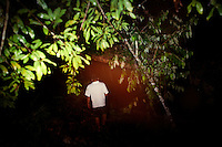 Iquitos, Peru, September 13, 2013 - Single exposure portrait of guide Wellington walking through the jungle.